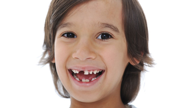 """Should Parents """"Help Out"""" a Loose Baby Tooth?"""