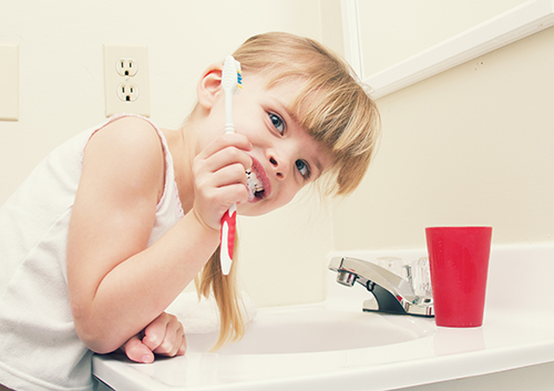 Ease up on your gums — don't brush your teeth too hard!