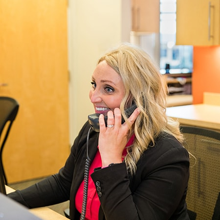 One of our team members talking to new patients on the phone