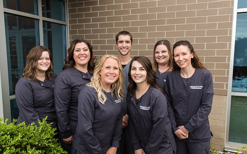 Our group of orthodontic assistants smiling in their uniforms
