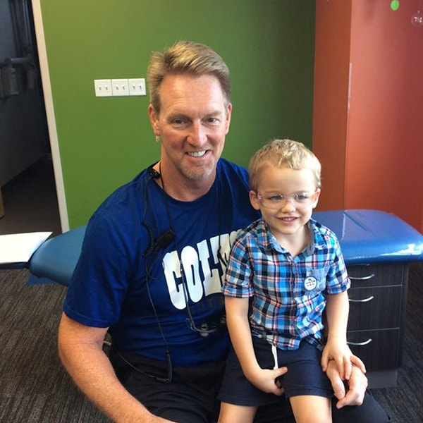 Our preventative care expert, Dr. Steve in the dental office with a young male patient
